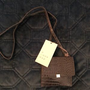 Grey croc print card holder. NWT
